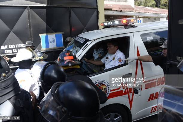 An ambulance arrives at the children's shelter Virgen de la Asuncion after a fire at the facility killed at least 19 people in San Jose Pinula about...