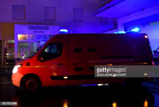 An ambulance arrives at the emergency department of the hospital of Trousseau in Tours on January 12 2017 French hospitals are being stretched to...