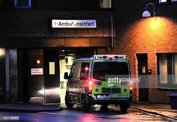 An ambulance arrives at the emergency entrance at the Karolinska hospital in Stockholm on March 30 2012 where former French Prime Minister Michel...