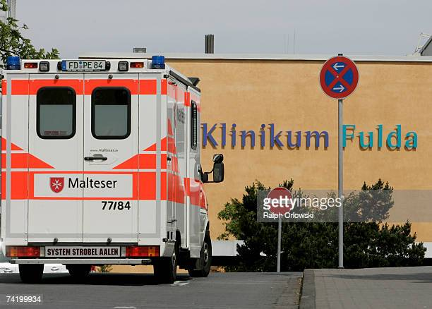 An ambulance arrives at the municipal clinical center where patients with salmonella infections are treated on May 20 2007 in Fulda Germany According...