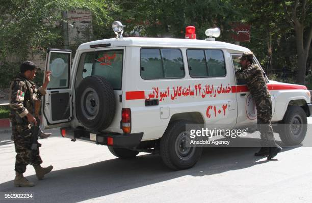 An ambulance arrives at the scene after twin explosions targeted central Kabul Afghanistan on April 2018 At least 21 people were reported dead and 27...