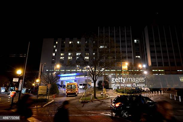 An ambulance arrives on December 30 at the emergency department at the Centre Hospitalier Universitaire hospital in Grenoble French Alps where German...