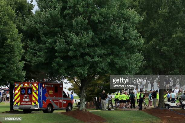 An ambulance arrives to provide medical assistance after a lightning strike during a suspension of the third round due to inclement weather of the...