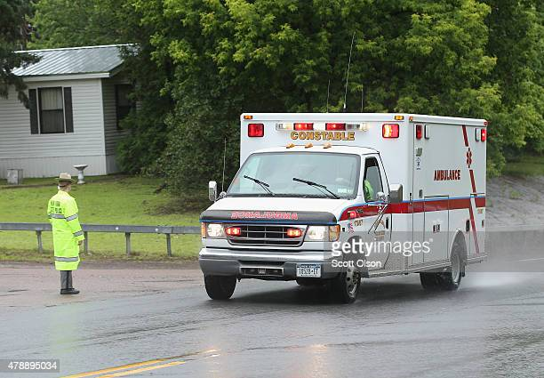 An ambulance believed to be transporting convicted murderer David Sweat is escorted by NY State Police to Alice Hyde Medical Center on June 28 2015...