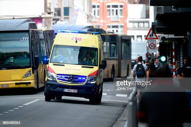 An ambulance car drives in the eastern Belgian city of Liege on May 29 near the site where a gunman killed two female police officers and a man in a...