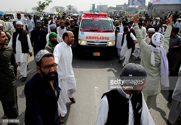 An ambulance carries the body of Mumtaz Qadri former police bodyguard who shot dead Punjab's governor Salman Taseer in Islamabad in 2011 over his...