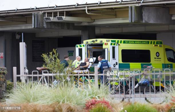 An ambulance carries wounded person to the hospital after gunmen attacked the two mosques and fired multiple times during Friday prayers in...