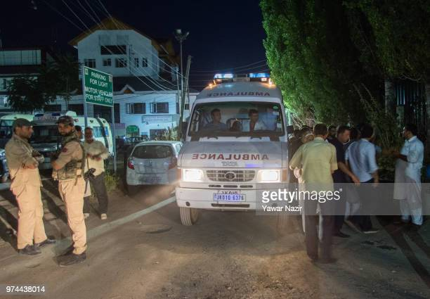 An ambulance carry the body of Syed Shujaat Bukhari the editor of Rising Kashmir daily newspaper who was killed by unidentified gunmen outside his...