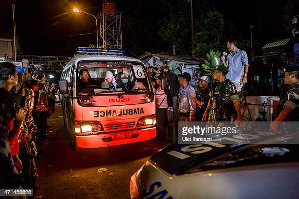 An ambulance carrying a coffin containing the body of one of the eight drug traffickers leaves Wijaya Pura port after the execution at Nusakambangan...