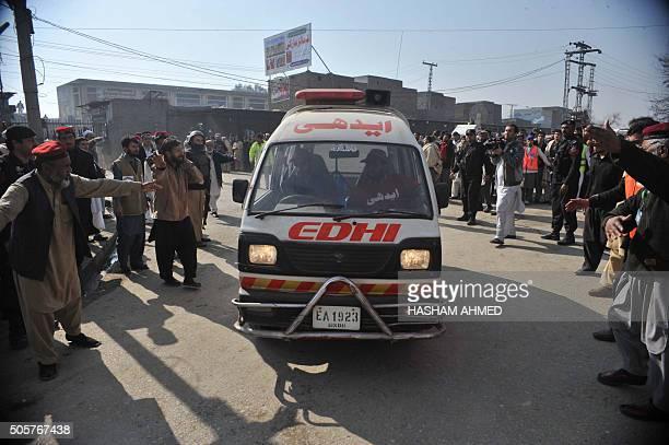 An ambulance carrying injured victims enters a hospital following an attack by gunmen at Bacha Khan university in Charsadda about 50 kilometres from...