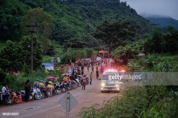 An ambulance carrying one of the boys rescued from Tham Luang Nang Non cave heading towards the hospital on July 8 2018 in Chiang Rai Thailand Divers...