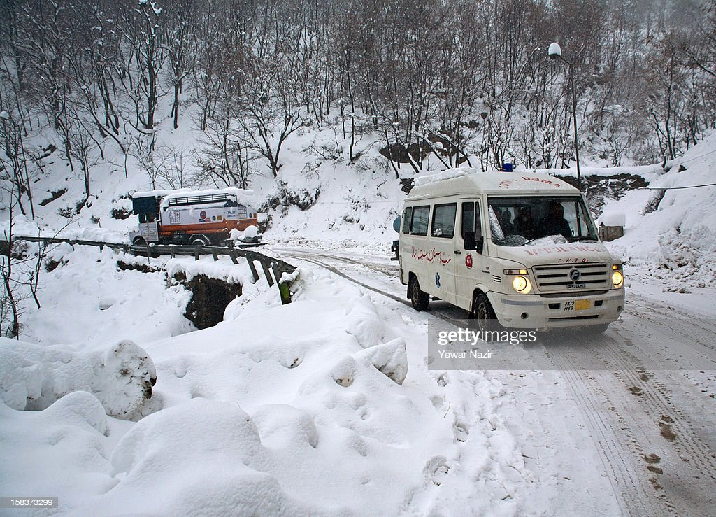 An ambulance carrying patients negotiates amid heavy snowfall on highway on December 14, 2012 in Banihal, 110 km (68 miles) south of Srinagar, the summer capital of Indian Administered Kashmir, India. Most parts of the Kashmir Valley, including Srinagar, received fresh snowfall, leading to closure of the 300 km (188 miles) Jammu-Srinagar Highway, the only road link between Kashmir and rest of India. Project Beacon authorities of the Border Roads Organisation, that maintains the highway, had already started efforts to clear the highway for traffic. The number of vehicles stranded on the highway was being ascertained.