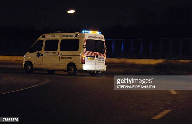 An ambulance carrying some of French charity organisation Zoe's Ark members is seen outside Le Bourget airport north of Paris 28 December 2007 after...