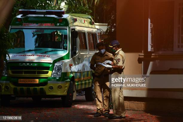 An ambulance carrying the body of Indian Bollywood actor Sushant Singh Rajput is seen after he took his own life, at his residence in Mumbai on June...