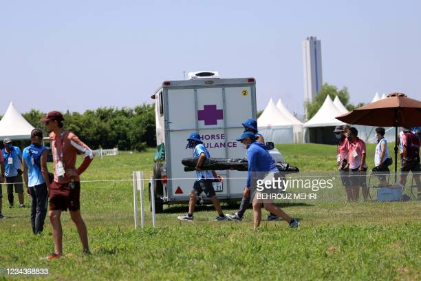 An ambulance carrying the horse Jet Set of Switzerland's Robin Godel is seen after the horse was injured in the equestrian's eventing team and...