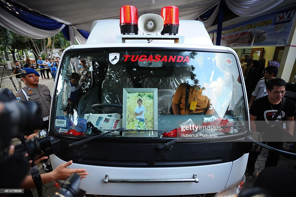 An ambulance containing remains of Brian Youvito Jou, a victim of the AirAsia flight QZ8501 disaster, departs from Bhayangkara Police Hospital after a handover ceremony on January 6, 2015 in Surabaya, Indonesia. A massive recovery operation is underway in waters off Borneo to recover bodies and debris from the missing AirAsia plane. AirAsia announced that flight QZ8501 from Surabaya to Singapore, with 162 people on board, lost contact with air traffic control at 07:24 a.m. local time on December 28.