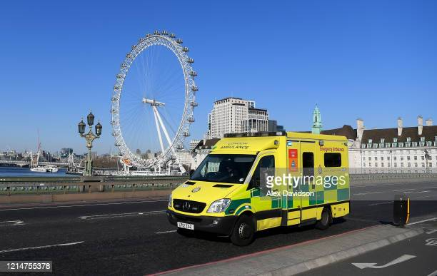 An Ambulance crosses Westminster Bridge on March 25 2020 in London England British Prime Minister Boris Johnson announced strict lockdown measures...