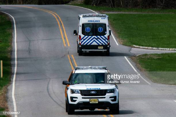 An ambulance departs Andover Subacute and Rehabilitation Center on April 16 2020 in Andover New Jersey After an anonymous tip to police 17 people...