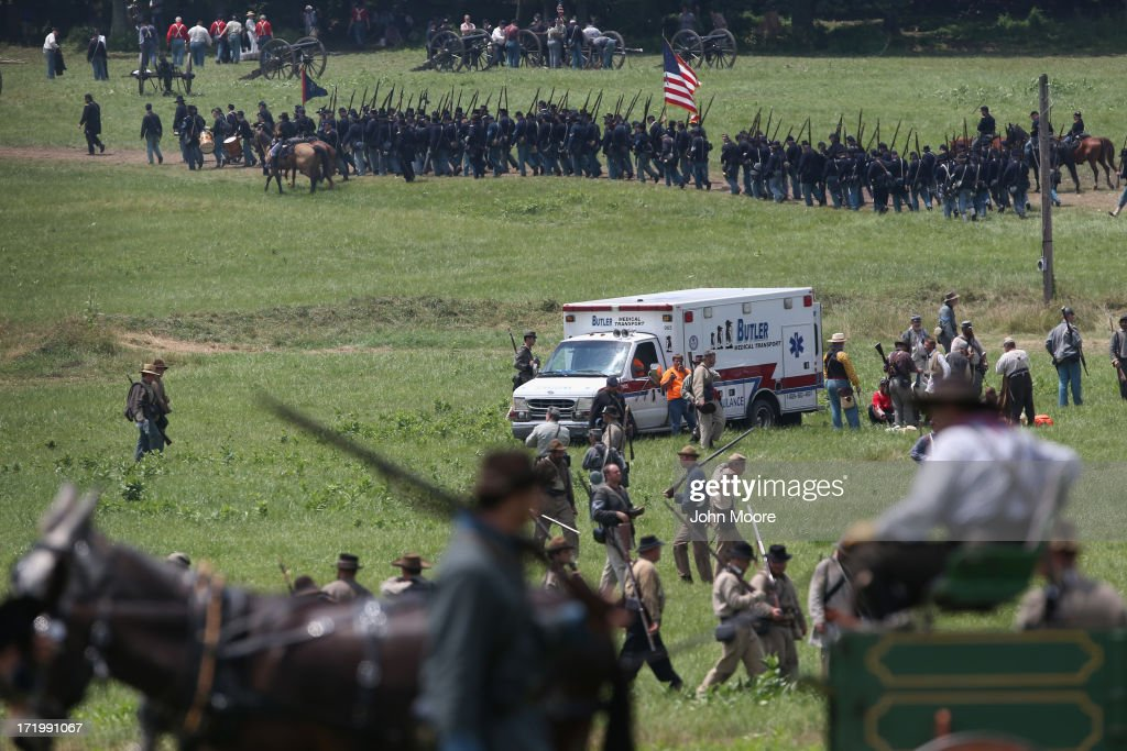 An ambulance departs at the end of Pickett's Charge on the last day of a Battle of Gettysburg re-enactment on June 30, 2013 in Gettysburg, Pennsylvania. Several people were taken away from the event due to heat exhaustion. Some 8,000 re-enactors from the Blue Gray Alliance participated in the re-enactment, marking the 150th anniversary of the July 1-3, 1863 Battle of Gettysburg. Confederate General Robert E. Lee's Army of Northern Virginia was routed during the doomed frontal assault, considered the turning point in the Civil War and a watershed moment in U.S. history. Union and Confederate armies suffered a combined total of up to 51,000 casualties over three days, the highest number of any battle in the four-year war. Pickett's charge was named for the Confederate Maj. General George Pickett, whose division of rebel troops was annhilated in the attack.