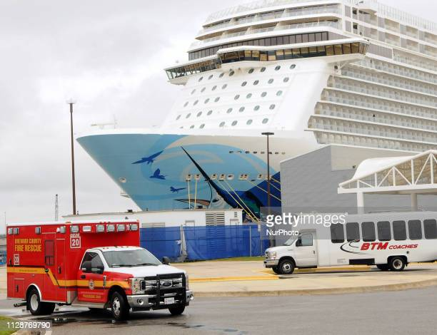An ambulance departs the Norwegian Escape cruise ship during a port of call at Port Canaveral Florida on March 5 2019 after guests and crew were...