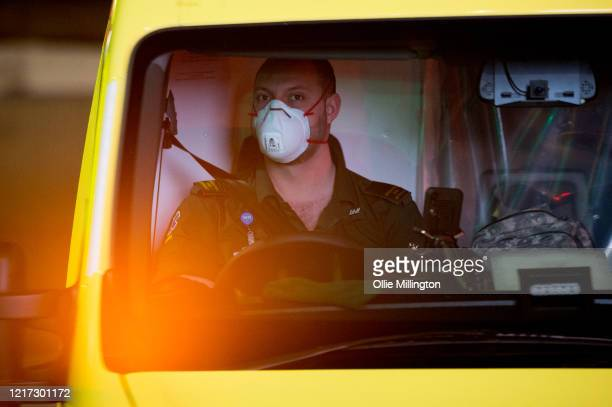 An ambulance driver outside St Thomas Hospital in Westminster, where British Prime Minister Boris Johnson has now been transferred to the ICU after...