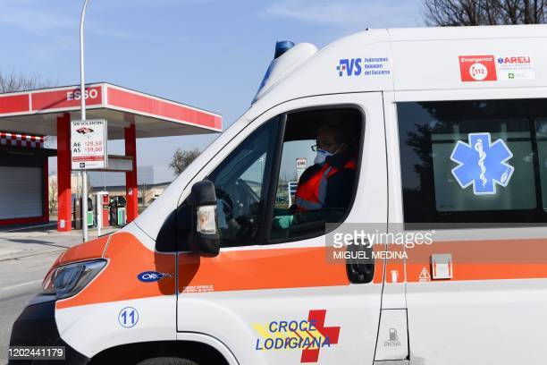 An ambulance driver wearing a surgical amsk leaves the municipal hospital in Codogno southeast of Milan on February 22 2020 Streets were deserted and...