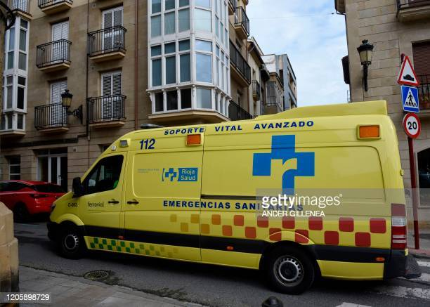 An ambulance drives down the street in the northern Spanish town of Haro on March 8 2020 Around 30 people are kept at their homes under active...