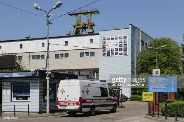 An ambulance drives near the Zofiowka mine after its was hit by a quake on May 5 2018 in JastrzebieZdroj in the Polish southern Silesia region Five...