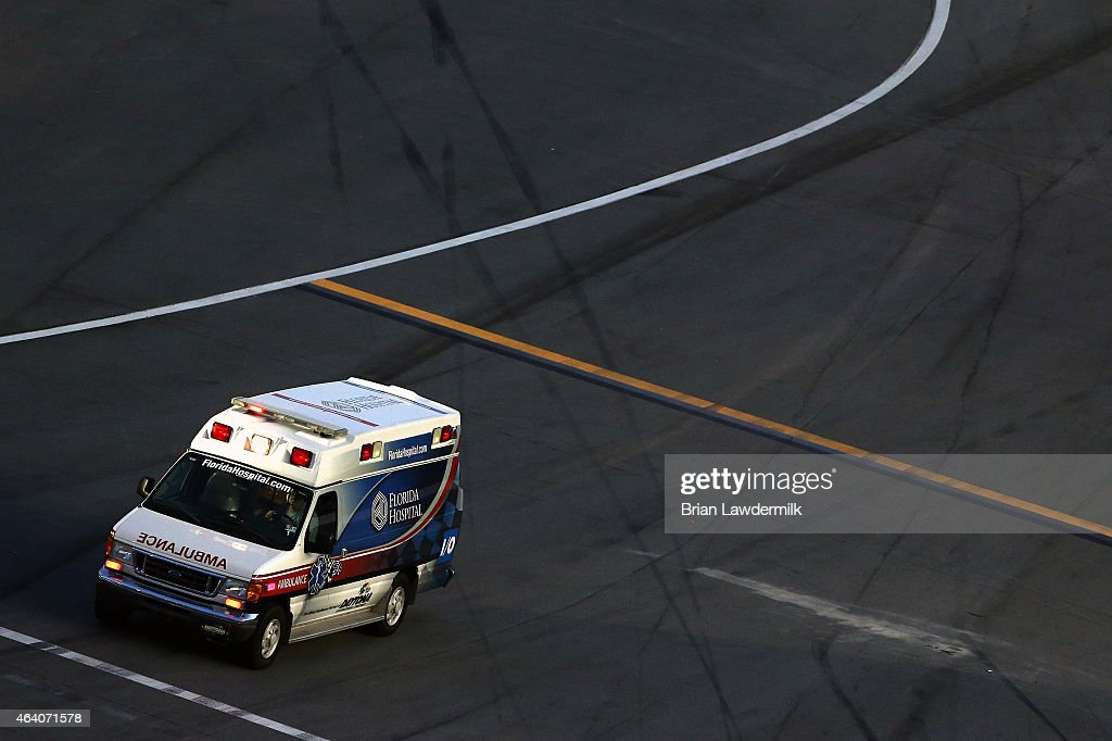 An ambulance drives on pit road after a multiple car crash during the NASCAR XFINITY Series Alert Today Florida 300 at Daytona International Speedway on February 21, 2015 in Daytona Beach, Florida. Kyle Busch, driver of the #54 Monster Energy Toyota, who was involved in the incident, was transported to a local hospital with a lower body injury.