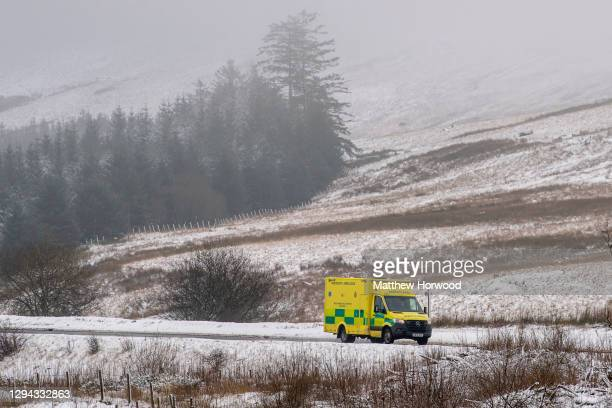 An ambulance drives on the A470 near Pen y Fan mountain on January 03, 2021 in Brecon, Wales. The Met Office have issued a yellow weather warning for...