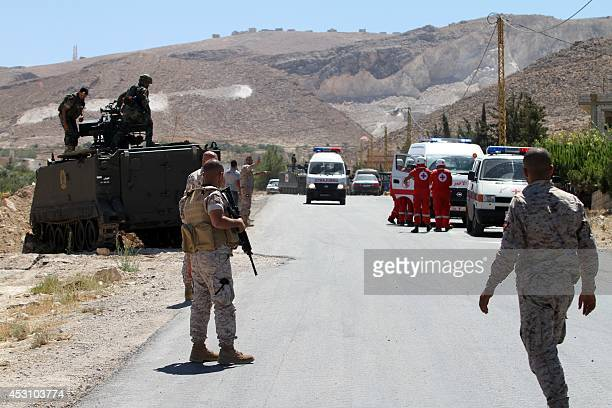An ambulance drives out of the Lebanese town of Arsal in the Bekaa valley near the border with Syria on August 3 2014 Gunmen have killed eight...