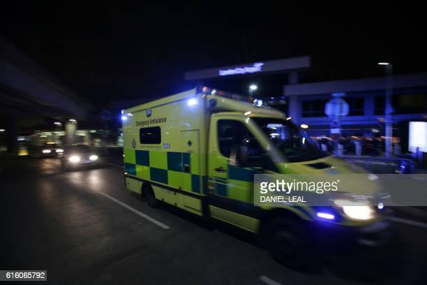 An Ambulance drives past London's City Airport on October 21 2016 after an evacuation Hundreds of passengers and staff were evacuated from London...