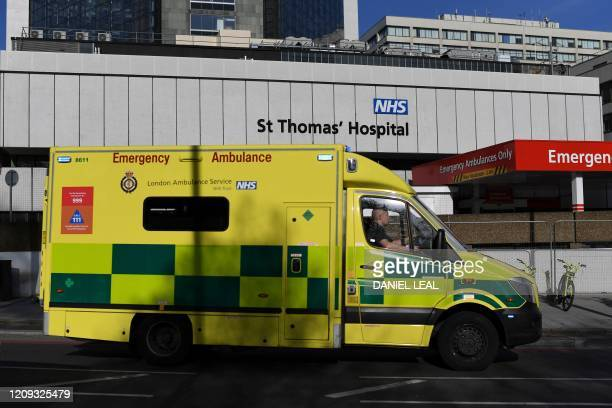 An ambulance drives past St Thomas' Hospital in central London where Britain's Prime Minister Boris Johnson is in intensive care on April 7 2020...
