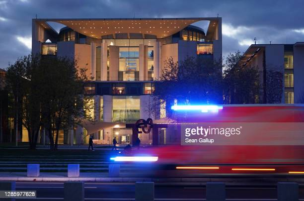 An ambulance drives past the Chancellery, where inside German Chancellor Angela Merkel was holding a virtual meeting with leaders of Germany's 16...