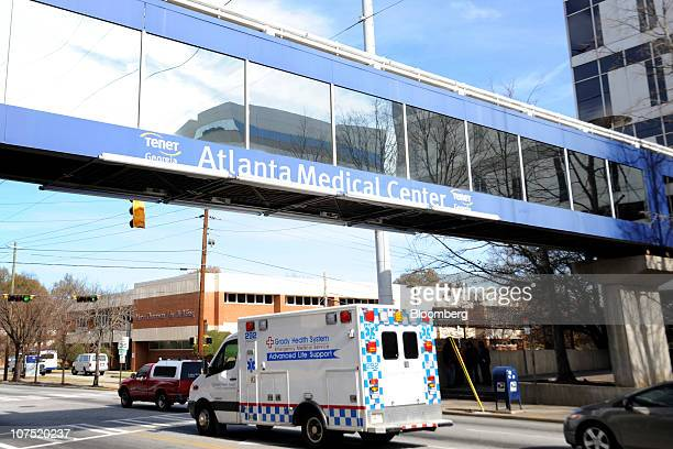 An ambulance drives under an overpass outside of Tenet Healthcare's Atlanta Medical Center in Atlanta Georgia US on Friday Dec 10 2010 Community...