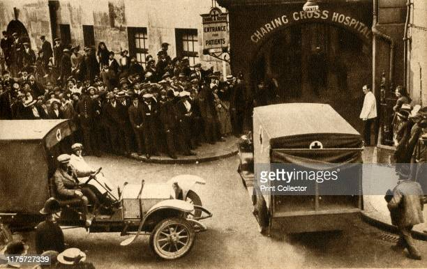 An ambulance driving into Charing Cross Hospital with casualties from the bloody battle at Mons' London Crowds watching ambulances carrying injured...