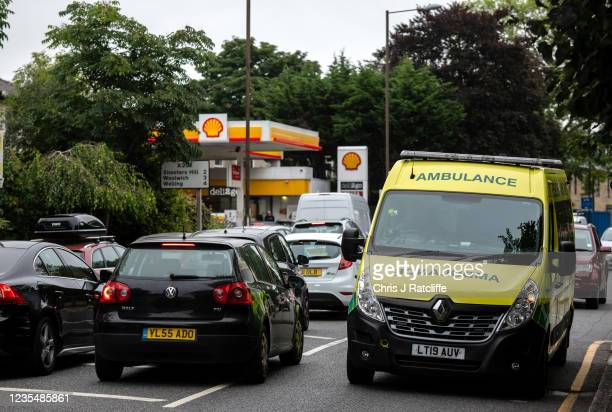 An Ambulance exits a Shell garage, which doesn't have any unleaded petrol, after filling up on fuel on September 25, 2021 in Blackheath, London,...
