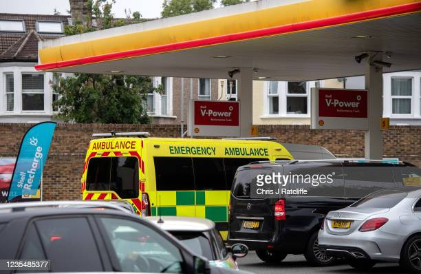 An Ambulance fills up with fuel at a Shell garage where there is no unleaded petrol but people queue for diesel on September 25, 2021 in Blackheath,...