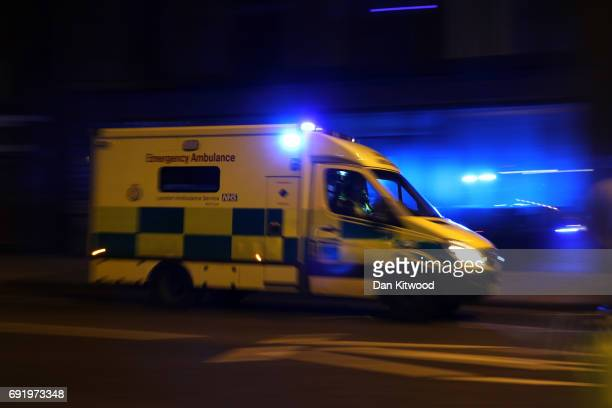 An ambulance heads North from London Bridge on June 3 2017 in London England Police have responded to reports of a van hitting pedestrians on London...
