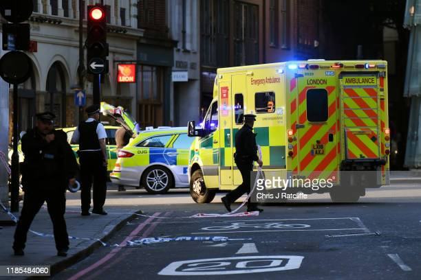 An ambulance is let through a police cordon near Borough Market after a number of people are believed to have been injured after a stabbing at London...