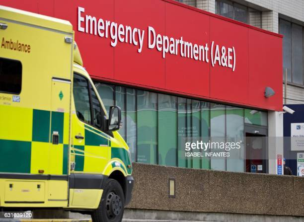 An ambulance is parked outside the Accident and Emergency department at St Thomas' Hospital on January 13 2017 in London The Red Cross describes a...