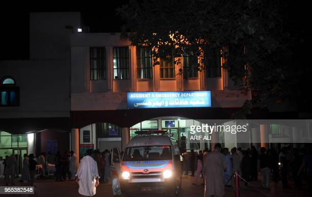 An ambulance is parked outside the hospital emergency after shifting injured Pakistan interior minister Ahsan Iqbal in Lahore on May 6 2018...