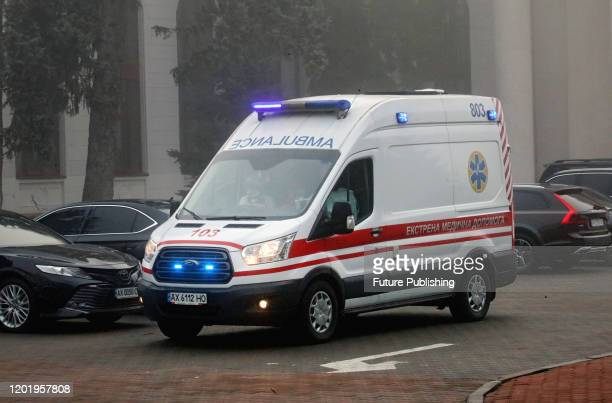 An ambulance is pictured at the Kharkiv International Airport, Kharkiv, northeastern Ukraine. The plane with 48 Ukrainians and 29 foreign nationals...