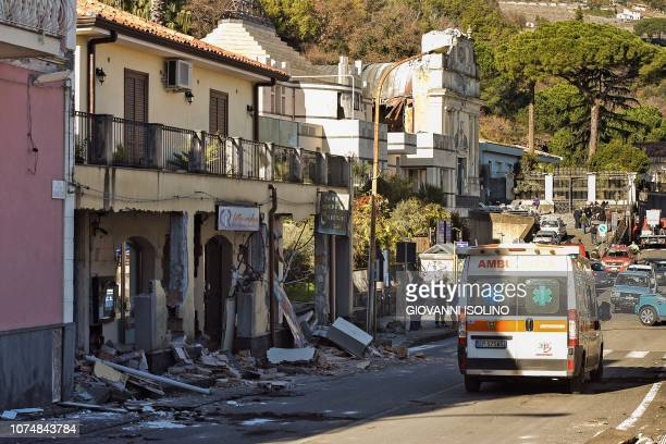 An ambulance is pictured outside damaged buildings in Zafferana Etnea near Catania on December 26 after a 4.8-magnitude earthquake hit the area...