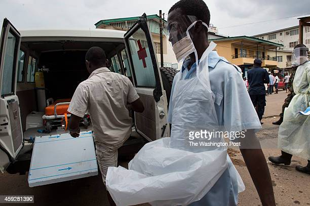 An ambulance is prepped for the transfer of Ebolasuspected patients from Connaught Hospital to nearby holding centers with available beds in Freetown...