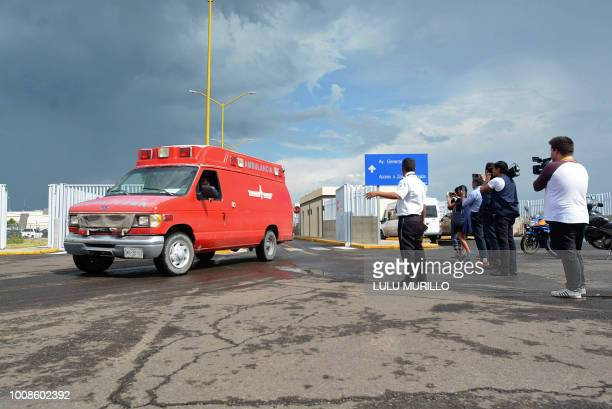 An ambulance is seen at the airport of Durango in northern Mexico after a plane carrying 97 passengers and four crew crashed during take off on July...