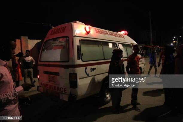 An ambulance is seen at the site after a terror attack with a bombladen vehicle exploded a hotel on the Lido beach Mogadishu Somalia on August 16...