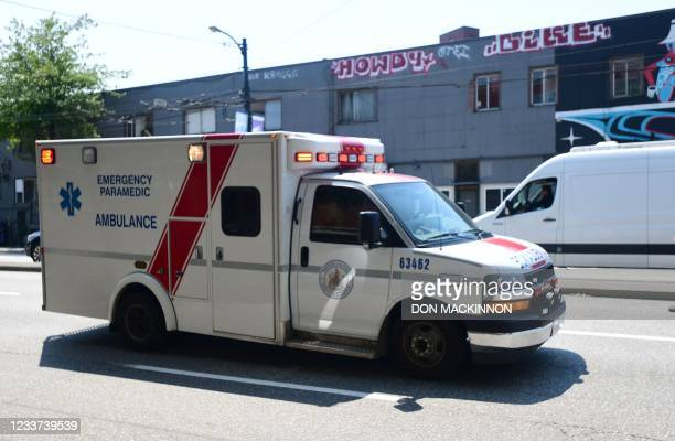 An ambulance is seen during the extreme hot weather in Vancouver, British Columbia, Canada, June 30, 2021. - Inside one of Vancouver's 25...