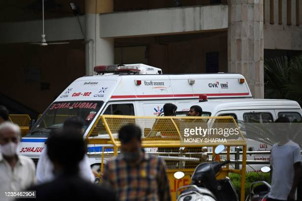 An ambulance is seen inside the Rohini court in New Delhi on September 24 after a notorious Indian gangster was killed by gunmen dressed as lawyers...