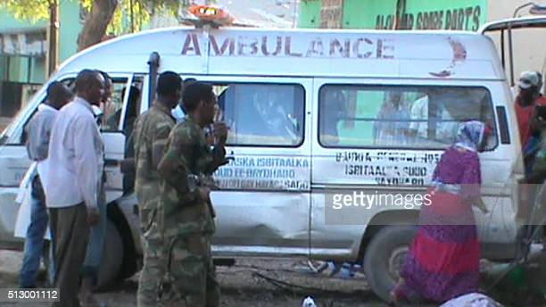 An ambulance is seen on 28 February 2016 in Baidoa after twin explosions in the Somali city killed at least 30 people An initial car bomb struck a...